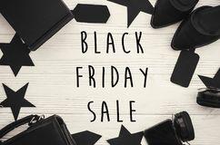 Black Friday big sale text sign, minimalistic flat lay. Special. Discount christmas offer. Stylish advertising message at black gift boxes, price tags on white royalty free stock photos