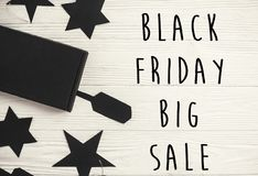 Black Friday big sale text sign, minimalistic flat lay. Special. Discount christmas offer. Stylish advertising message at black gift boxes, price tags on white royalty free stock photo