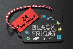 Black Friday. Text on a black tag with red and white twine Royalty Free Stock Photos