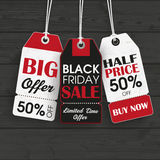 Black Friday Black Wooden Background. Price stickers for black friday sale Royalty Free Stock Photography