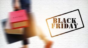 Black Friday, Blurred woman carrying shopping bags stock photos