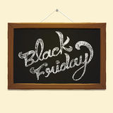 Black Friday calligraphy over blackboard Stock Images