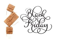 Black Friday calligraphy text on white background and gifts. Hand written Royalty Free Stock Image