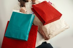 Black Friday. Christmas Sales. Happy Girl holding colorful shopping bags on white background. Space for text. Cyber Monday. Chris. Tmas Shopping and seasonal royalty free stock photography