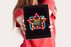 Black friday concept. Cropped hand of woman holding digital tablet with sale advertisement. Black friday concept Royalty Free Stock Photography