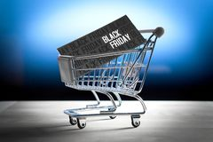 Black friday concept. Grand sale after Thanksgiving. Online shopping, e commerce and internet store concept. Miniature shopping cart with www letters Royalty Free Stock Image