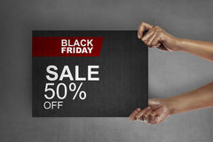 Black friday concept. Hand holding signboard with sale discount on Black Friday. Black friday concept Royalty Free Stock Photos