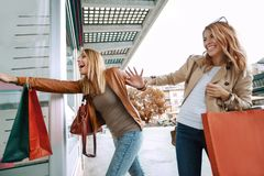 Black friday concept.Happy friends shopping. Two beautiful young women enjoying shopping in the city stock images