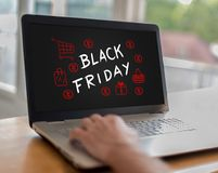 Black friday concept on a laptop. Man using a laptop with black friday concept on the screen Royalty Free Stock Image