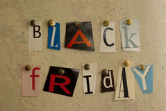 Black Friday cut outs. Newspaper cut out letters on a wall spelling out Black Friday royalty free stock photos