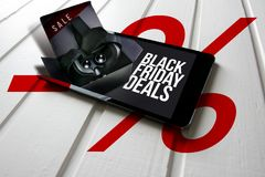 Black friday deals, promotion on computer tablet screen, box wit. H virtual reality glasses come out of the tablet screen. Conceptual image Stock Image