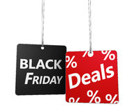Black Friday Deals Tags. Black Friday deals and shopping sale concept with sign and percent symbol on hanged price tags isolated on white background Royalty Free Stock Photography