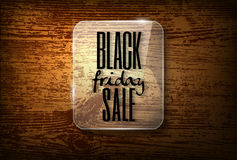 Black friday design  in glass frame on  vector wooden back Royalty Free Stock Photos