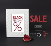 Black Friday discount banner, with a vintage female black wallet in front of it. Black Friday discount banner. White photo-frame on a black background, with a Royalty Free Stock Image