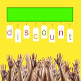 Black friday. Discount word on labels people hands. Black friday. Discount word on labels over yellow gradient background, people's hands lifted up in the air Stock Photography