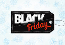 Black Friday försäljningsetikett på snöflingabakgrund Arkivfoton