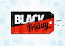 Black Friday försäljningsetikett på snöflingabakgrund Royaltyfri Fotografi
