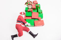 Black Friday 2016, funny Santa delivering gift boxes and girl Royalty Free Stock Image