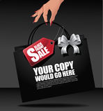 Black Friday hand holding shopping bag background Royalty Free Stock Photos