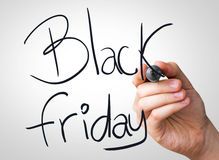 Black Friday hand writing with a black mark on a transparent board Stock Photography