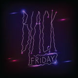 Black friday handdrawn linear neon inscription on dark  Royalty Free Stock Image