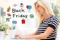 Black Friday with happy young woman in front of the computer. Black Friday with happy young woman sitting at her desk in front of the computer royalty free stock photos