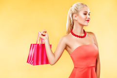 Black friday. Happy young woman shopping in holiday. Girl showing on bag with copy space Stock Image