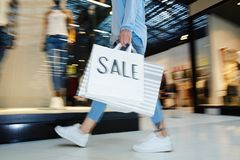 Black Friday haste. Modern shopper rushing for hot black friday sale in modern mall Royalty Free Stock Photos