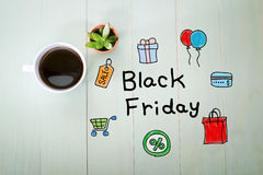 Black Friday message with a cup of coffee Stock Image