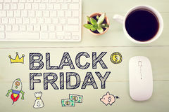 Black Friday message with workstation. On a light green wooden desk Stock Photography