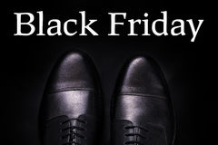 Black friday.  oxford shoes on  background. Top view. Black friday. Black oxford shoes on black background. Top view Royalty Free Stock Photography