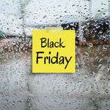 Black friday paper note on rain drop windows Stock Images