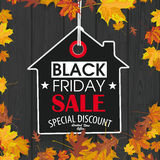 Black Friday Price Sticker House Autumn Foliage Black Wood. Black friday price sticker on the wooden background Royalty Free Stock Photo