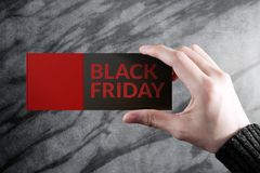 Black friday promotional concept, woman holding a discount coupo. N with blank space for text Stock Photos