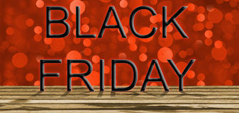 Black Friday on red bokeh light and wooden floor Royalty Free Stock Image