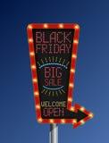 Black friday retro arrow light banner on blue background Stock Photo