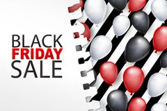 Black Friday Sale banner or card. Shiny balloons under a torn out sheet of paper. Big discount offer of the year design concept.