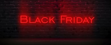 Black Friday sale, banner, poster. Dark background of old brick wall, red neon, smoke stock image