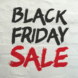 Black Friday Sale banner on white brick wall. Sale and Discounts Background. Black Friday Sale banner on white brick wall Royalty Free Stock Photos