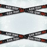 Black friday sale banners. Warning tapes, ribbons on winter background. Black friday sale banners. Warning tapes, ribbons on winter background with snow and Stock Photos