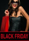 Black friday sale concept. Shopping woman holding bag isolated on dark background in holiday royalty free stock photo