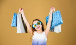 Black friday. Sale discount. Shopping day. Child fashion girl sunglasses hold package. Favorite kids brand. Girl with. Shopping bag. Shopping tour abroad stock photography