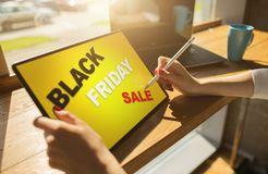 Black friday sale. E-commerce and online shopping concept on tablet screen. Black friday sale. E-commerce and online shopping concept on tablet screen royalty free stock photography