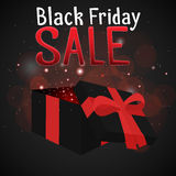 Black Friday sale with a festive box and sparkles. For your design Stock Images