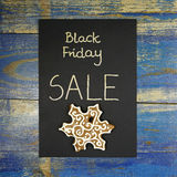 Black Friday Sale with gingerbread on black card Royalty Free Stock Images