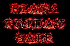 Black Friday Sale in glowing red text. On black Stock Photos