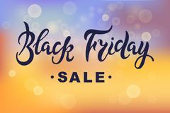 Black Friday sale lettering on sunset abstract background with bokeh. Royalty Free Stock Photo