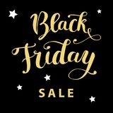 `Black Friday sale`hand lettering golden text on a black background Stock Photo
