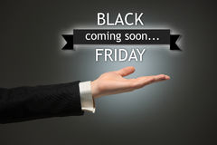 Black Friday sale - holiday shopping concept. Text and male hand on black Stock Images