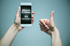 Black Friday sale - holiday shopping concept. Text on mobile phone in female hands Stock Photos